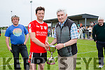 Oran Clifford Captain of the Waterville side who defeated Skellig Rangers, in the Mick O'Dwyer Inaugural Football Tournament on Sunday held in Waterville pictured here receiving the coveted Cup from Micko.