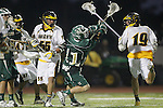Placentia, CA 05/14/10 - Austin Hafdell (MC # 11) dodges a couple of Foothill defenders as he keeps an eye on the ball to maintain control during the Mira Costa vs Foothill boys lacrosse game for the 2010 Los Angeles / Orange County CIF Championship.    ©2010 Dirk Dewachter  www.dewachter.net