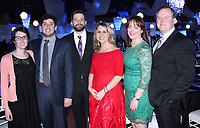 NWA Democrat-Gazette/CARIN SCHOPPMEYER Mary and Joel Eikenberry (from left), Nathan Eikenberry and Michelle Fittro and Stephanie and Dan Freedle help support Havenwood at the Journey Gala on Feb. 24 at Metroplex Event Center in Rogers.