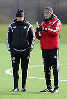 SWANSEA, WALES - JANUARY 28: Diego Bortoluzzi (R) and  head coach Francesco Guidolin (L) observe the players training during the Swansea City Training Session on January 28, 2016 in Swansea, Wales.