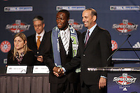 1st pick Round One Steve Zakuani chosen by Seattle Sounders shaking hands with MLS Commissioner Don Garber at the MLS Super Draft 2009.