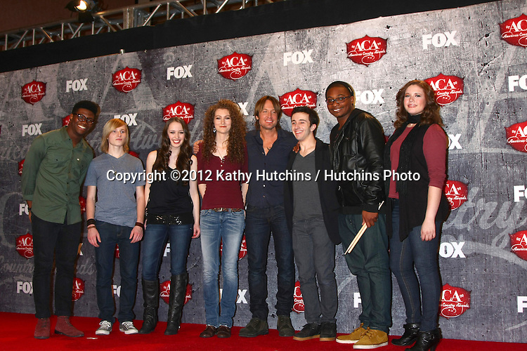 LOS ANGELES - DEC 10:  Keith Urban with Grammy Campers in the press room of the American Country Awards 2012 at Mandalay Bay Resort and Casino on December 10, 2012 in Las Vegas, NV