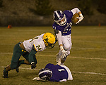 Spanish Springs Parker Luthy is hit by Manogue's Ezekial Lee (24) as he jumps over Mason Bebout (1) on Friday night, November 9, 2018 at Spanish Springs High School in Sparks, Nevada.