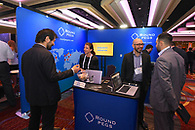 Networking at one of the conference corporate sponsor booths.