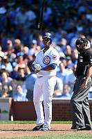 Chicago Cubs shortstop Starlin Castro (13) tosses his bat after striking out to finish the inning during a game against the Milwaukee Brewers on August 14, 2014 at Wrigley Field in Chicago, Illinois.  Milwaukee defeated Chicago 6-2.  (Mike Janes/Four Seam Images)