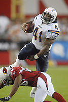 Aug 25, 2007; Glendale, AZ, USA; San Diego Chargers fullback Lorenzo Neal (41) leaps over an Arizona Cardinals defender in the first half at University of Phoenix Stadium. Mandatory Credit: Mark J. Rebilas-US PRESSWIRE Copyright © 2007 Mark J. Rebilas