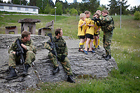 Meeting children during a break. Norwegian Home Guard soldiers during exercise Djerv..The Home Guard has traditionally been designated to secure important  domestic installations in case of war or crisis. With the cold war long gone, a war in Afghanistan and budget cuts, there is a debate over the Home Guard's role in the future.