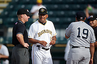 Bradenton Marauders Carlos Garcia #13, umpire Garrett Patterson (left), Luis Sojo #19, and Jose Esteras (right) before a Florida State League game against the Tampa Yankees at McKechnie Field on July 19, 2012 in Bradenton, Florida.  Bradenton defeated Tampa 4-3.  (Mike Janes/Four Seam Images)