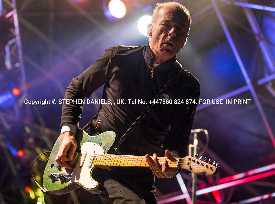 Status Quo , Francis Rossi on Stage Holkham Hall, Norfolk<br />  *NO INTERNET USE PERMITTED*  PRINT MEDIA ONLY<br /> &gt;<br /> DANPIC's; Photo by &copy; Stephen Daniels 23/08/2014 <br /> Francis Rossi - Rick Parfitt returns to the sage after his hart attack, play a concert - Holkham Hall, Norfolk with Status Quo.<br /> <br /> Minimum Fee &pound;200.00+vat<br /> &gt;<br /> All images supplied under the terms and condition of <br /> Stephen Daniels and not publication which use them.<br /> All images which is the copyright of Stephen Daniels<br /> and/or DANPICS are supplied under the terms and <br /> condition of Stephen Daniels<br /> &gt;<br /> Words by Medialincs Tel 07933 676119 Richard Vamplew
