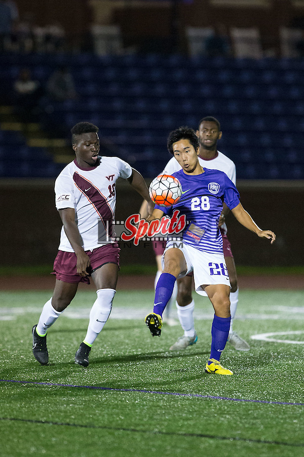 Ryeong Choi (28) of the High Point Panthers tries to control the ball in front of Ousmane Sanogo (10) of the Virginia Tech Hokies during second half action at Vert Track, Soccer & Lacrosse Stadium on October 13, 2015 in High Point, North Carolina.  The Panthers defeated the Hokies 2-1 in overtime.  (Brian Westerholt/Sports On Film)