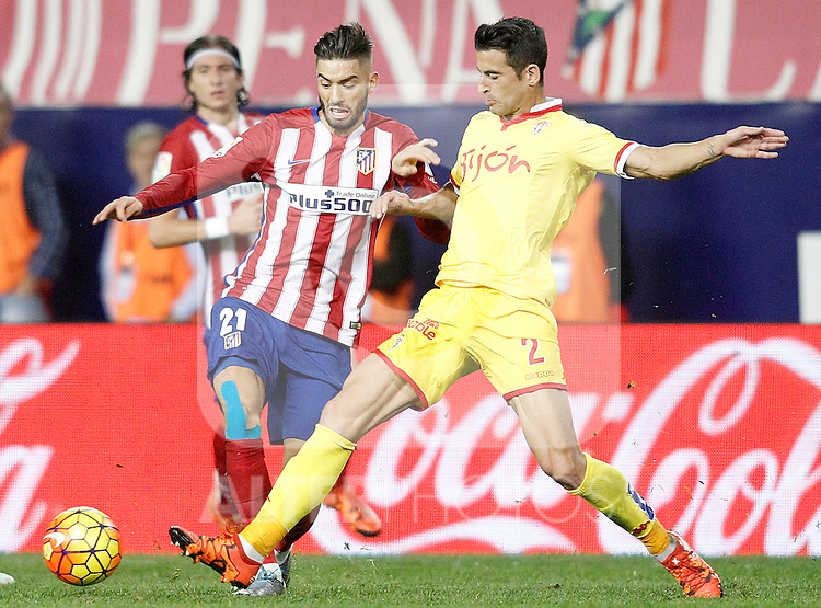 Atletico de Madrid's Yannick Ferreira Carrasco (l) and Sporting de Gijon's Luis Hernandez during La Liga match. November 8,2015. (ALTERPHOTOS/Acero)