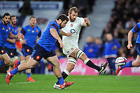 England captain Chris Robshaw hacks the ball ahead. RBS Six Nations match between England and France on March 21, 2015 at Twickenham Stadium in London, England. Photo by: Patrick Khachfe / Onside Images