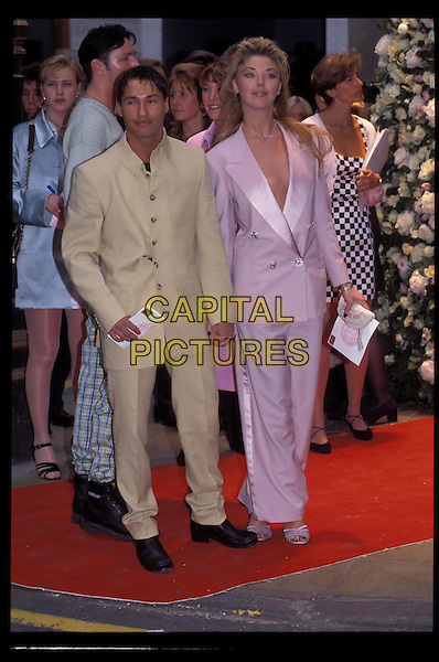 TAMARA BECKWITH.Ref:1303.holding hands, pink sandals, pink trousers, pink blazer, pink jacket, full length, full-length.RAW SCAN - PHOTO WILL BE ADJUSTED FOR PUBLICATION.www.capitalpictures.com.sales@capitalpictures.com.©Capital Pictures.