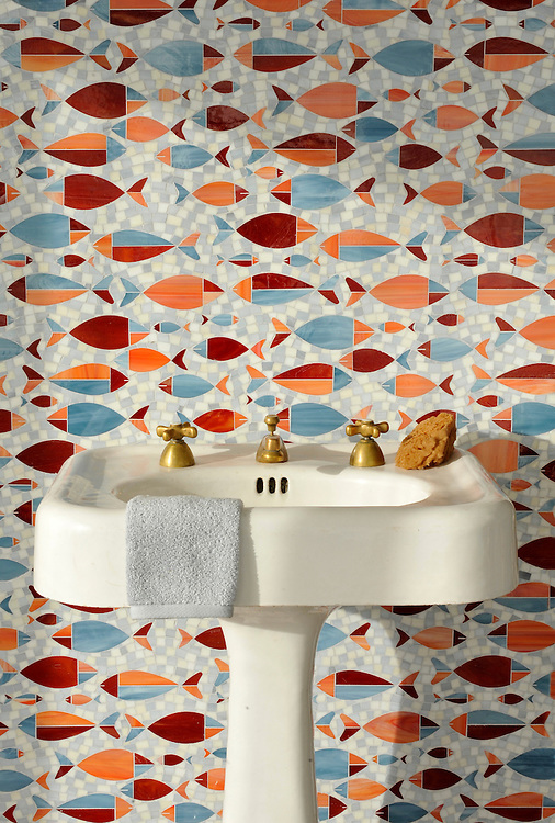 Floating Fish, a water jet jewel glass mosaic shown in Mica, Sardonyx, Garnet, Pearl, and Quartz, is part of the Erin Adams Collection for New Ravenna.