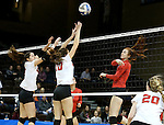 SIOUX FALLS, SD - DECEMBER 8:  Lauren Graves #25 from Wheeling Jesuit tips the ball past a pair of defenders including Caroline Stefanon #10 from Lewis during their quarterfinal match at the 2016 Women's Division II Volleyball Championship at the Sanford Pentagon in Sioux Falls, SD. (Photo by Dave Eggen/Inertia)