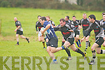 Killorglin's Andrew O'Reilly gets through the Scarriff defence at O'Dowd park, Tralee on Sunday.