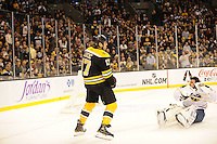 Boston Bruins left wing Milan Lucic #17 charges Buffalo Sabres goalie Ryan Miller #30 separating him from his mask. Boston Bruins left wing Milan Lucic #17 charge earned him a penalty for his efforts...