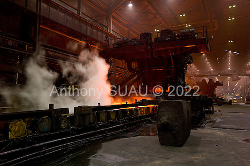 Dearborn, Michigan<br /> USA<br /> February 17, 2011<br /> <br /> The former Ford Rouge Steel Plant completed in 1928 is now owned, run and being renovated and expanded by Russian owner &quot;Severstal North America&quot;. This is one of five steel plants owned by Severstal in the United States and they are spending huge sums to convert it into what could be the continent's most efficient automotive steel plant.<br /> <br /> The hot strip mill operating at full speed and has an annual throughput of 3.8 million tons (3.5 million metric tons). <br /> <br /> Rouge Steel fell on hard times after Ford Motor Company spun it off in 1989 into an independent steel company. <br /> <br /> After buying the assets of the bankrupt company for USD 280 million, Severstal spent USD 350 million to repair one of the blast furnaces. The company built a new cold-rolling line which converts steel slabs into sheet metal. And it added a galvanizing line which coats sheet metal with zinc for rust-resistant body panels.<br /> <br /> The operation assets and improvements amount to USD 1.4 billion. Add in spending on a new mini mill in Columbus, Mississippi a USD 1.6 billion operation and Severstal has placed a USD 3 billion bet on North America auto industry.