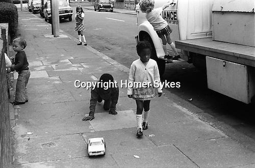Kids playing in street south London UK 1975