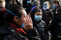 "Harvard students and community members gather for a ""die-in"" protest outside of Memorial Church in Harvard Yard in Cambridge, Massachusetts, USA. Many protestors wore face masks with the phrase ""I can't breathe,"" a reference to the last words of Eric Garner, a young black man who was killed by a police officer in New York City. The protest was meant to draw attention to the Garner's death and other recent police killings of black men, including the death of Michael Brown in Ferguson, Missouri."