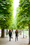 Paris, Tuileries Gardens, two friends walking, France