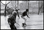 """Pro-Khomeini supporters attack """"Pro-Constitutionalists"""" Shah supporters. Tehran, January 24, 1979."""