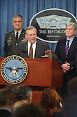 """The Pentagon is functioning"" was the message Defense Secretary Donald Rumsfeld stressed during a press conference in the Pentagon briefing room barely eight hours after terrorists crashed a hijacked commercial jetliner into the national military headquarters on Tuesday, September 11, 2001.  Pictured left to right: Chairman of the Joint Chiefs of Staff Army General Henry Shelton, U.S. Secretary of Defense Donald Rumsfeld, and U.S. Senator John Warner (Republican of Virginia). .Mandatory Credit: Bob Houlihan - DoD via CNP."