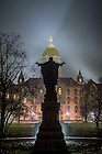 January 16, 2017; Sacred Heart Jesus statue and Main Building on a foggy night. (Photo by Matt Cashore/University of Notre Dame)