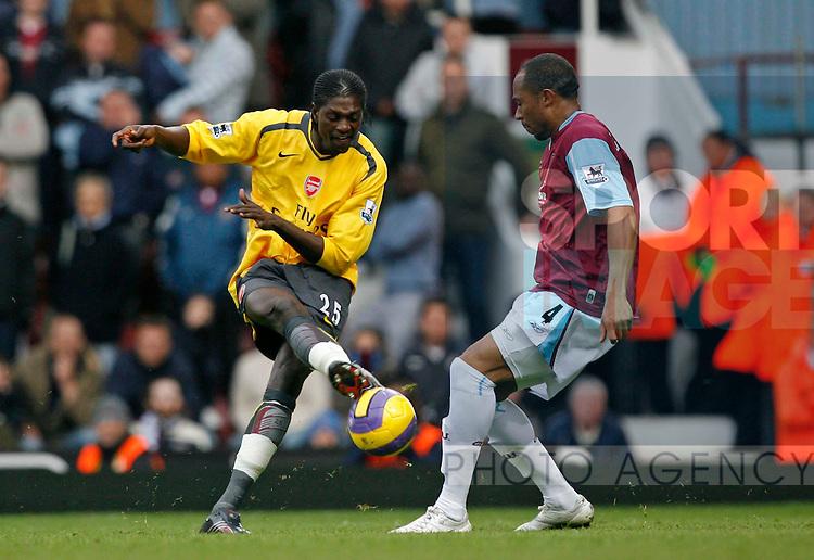 Arsenal's Emmanuel Adebayor (L) and West Ham's Danny Gabbidon.