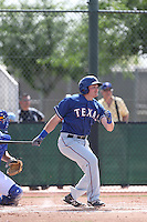 Preston Beck #25 of the Texas Rangers bats during a Minor League Spring Training Game against the Kansas City Royals at the Kansas City Royals Spring Training Complex on March 20, 2014 in Surprise, Arizona. (Larry Goren/Four Seam Images)