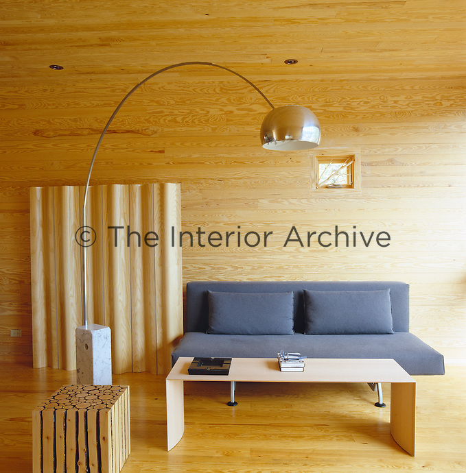 This modern box-car construction known as 'The Tube' is lined with pine and furnished with classics such as the Eames screen and Arco lamp