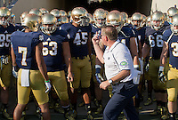 Coach Kelly leads his team onto the field after halftime.