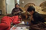 17/04/15. Goktapa, Iraq. Dhuha and Ali painting.