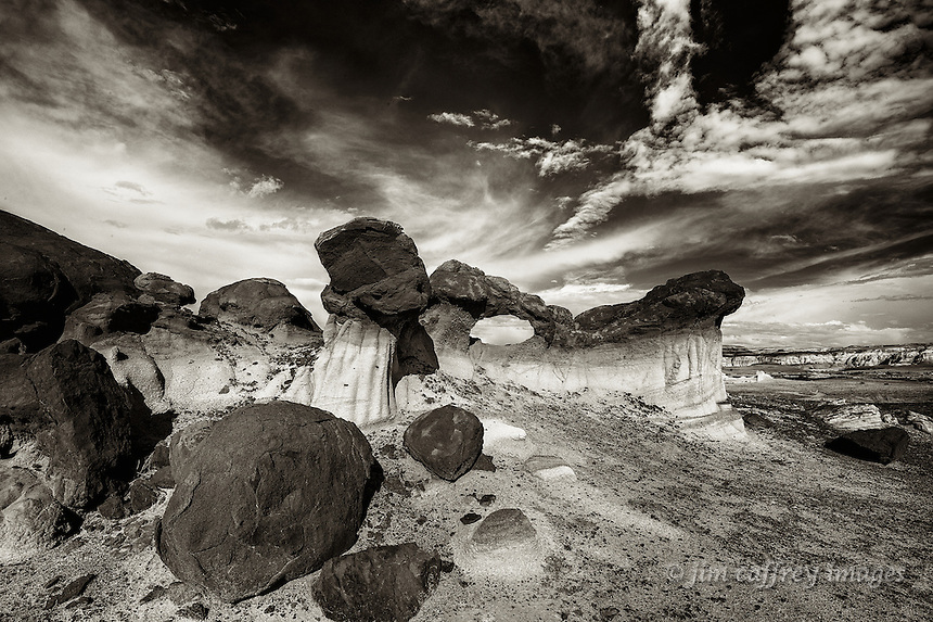 A black and white image of the Bisti Arch in Alamo Wash at the Bisti Wilderness in northwestern New Mexico.