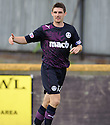 Partick's Mark McGuigan celebrates after scoring the winner.