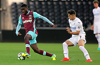 Pictured L-R: Moses Makasi of West Ham United against Dan James of Swansea Friday 26 August 2016<br /> Re: Swansea City FC v West Ham United, Division 2, Premier League 2, at the Liberty Stadium, Swansea, Wales, UK