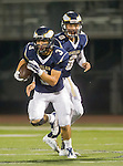 El Segundo, CA 10/30/14 - Miguel Wagner-Bagues (El Segundo #3) and Lars Nootbaar (El Segundo #8) in action during the Lawndale - El Segundo Varsity football game at El Segundo High School.  El Segundo defeated Lawndale 35-14.