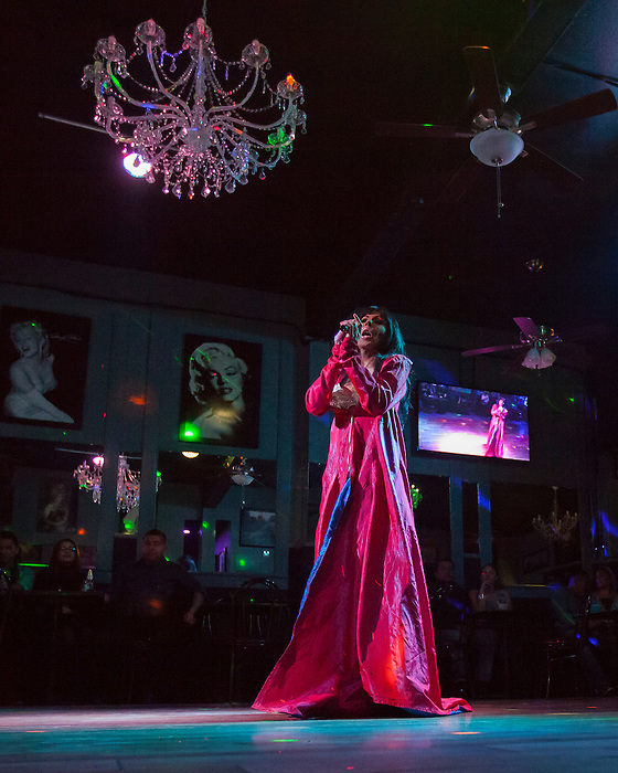 Melanie Machetto sings during a weekly drag show at Franco's Norma Jean's Nightclub in Castroville, Calif. on December 18, 2015.