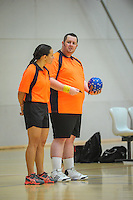 Match officials wait for the start of the International Handball Federation Trophy Oceania tournament men's semifinal match between New Calerdonia (grey tops) and Australia (gold tops) at ASB Sports Centre, Kilbirnie, Wellington, New Zealand on Friday, 12 December 2014. Photo: Dave Lintott / lintottphoto.co.nz