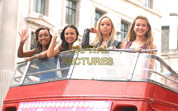 BRATZ stars Cloe (Skyler Shaye), Jade (Janel Parrish), Sasha (Logan Browning) and Yasmin (Nathalia Ramos) arrive on the BRATZ tour bus to promote their new film BRATZ The Movie, Hamleys, London, England..15th August 2007.half length waving .CAP/BEL.©Belcher/Capital Pictures