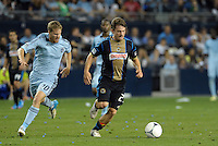 Union's Antoine Hoppenot (29) goes past Sporting's Oriol Rosell..Sporting Kansas City defeated Philadelphia Union 2-1 at LIVESTRONG Sporting Park, Kansas City, KS.