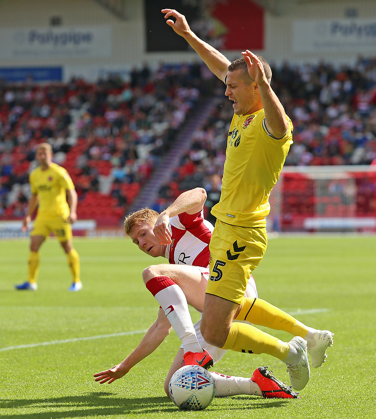 Fleetwood Town's Paul Coutts is fouled by Doncaster Rovers' Tom Anderson<br /> <br /> Photographer David Shipman/CameraSport<br /> <br /> The EFL Sky Bet League One - Doncaster Rovers v Fleetwood Town - Saturday 17th August 2019  - Keepmoat Stadium - Doncaster<br /> <br /> World Copyright © 2019 CameraSport. All rights reserved. 43 Linden Ave. Countesthorpe. Leicester. England. LE8 5PG - Tel: +44 (0) 116 277 4147 - admin@camerasport.com - www.camerasport.com