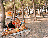 CROATIA, Dalmatian coast, people relaxing on beach at Hvar