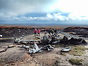 03/11/14<br /> <br /> Walkers pay their respects near  wreckage at a crash site where thirteen airmen were killed when their bomber hit remote moorland high up in the Peak District 66 years ago today.<br /> <br /> Amazingly, the area on Bleaklow Moor is so remote that many of the aircraft&rsquo;s twisted remains, including at least two of engines from the B29 Superfortress still litter the site today.<br /> <br /> The American bomber, known as &lsquo;Over-Exposed!&rsquo; had been converted into a photo reconnaissance aircraft.<br /> <br /> In some of its earlier flights it had been used to photograph the nuclear bomb tests at Bikini Atoll in the Pacific Ocean and had also taken part in the Berlin airlift.<br /> Captain Landon P. Tanner took off on the morning of 3rd November 1948, at around 10.15 from Scampton, Lincolnshire heading on a routine flight to Burtonwood USAF base in Warrington. The B29 was carrying USAF wages among other things. The crew were due to return to the States in a few days.<br /> When &lsquo;Over Exposed!&rsquo; failed to arrive at Burtonwood an air search was initiated, and that afternoon blazing wreckage was spotted high on the moors near Higher Shelf Stones. By chance members of the Harpur Hill RAF Mountain Rescue Unit were just finishing an exercise two and a half miles away, so they quickly made their way to the scene of the crash but there was clearly nothing that could have been done for any of the crew.<br /> This is just one of 180 military and civilian aircraft that have crashed in and around the Peak District since 1918.<br /> <br /> All Rights Reserved - F Stop Press.  www.fstoppress.com. Tel: +44 (0)1335 300098