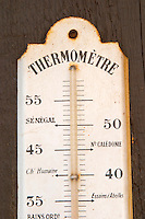 Old thermometer on the wall. Marked with Cold Record in Paris 1871, and other strange words. Domaine Marc Kreydenweiss, Andlau, Alsace, France