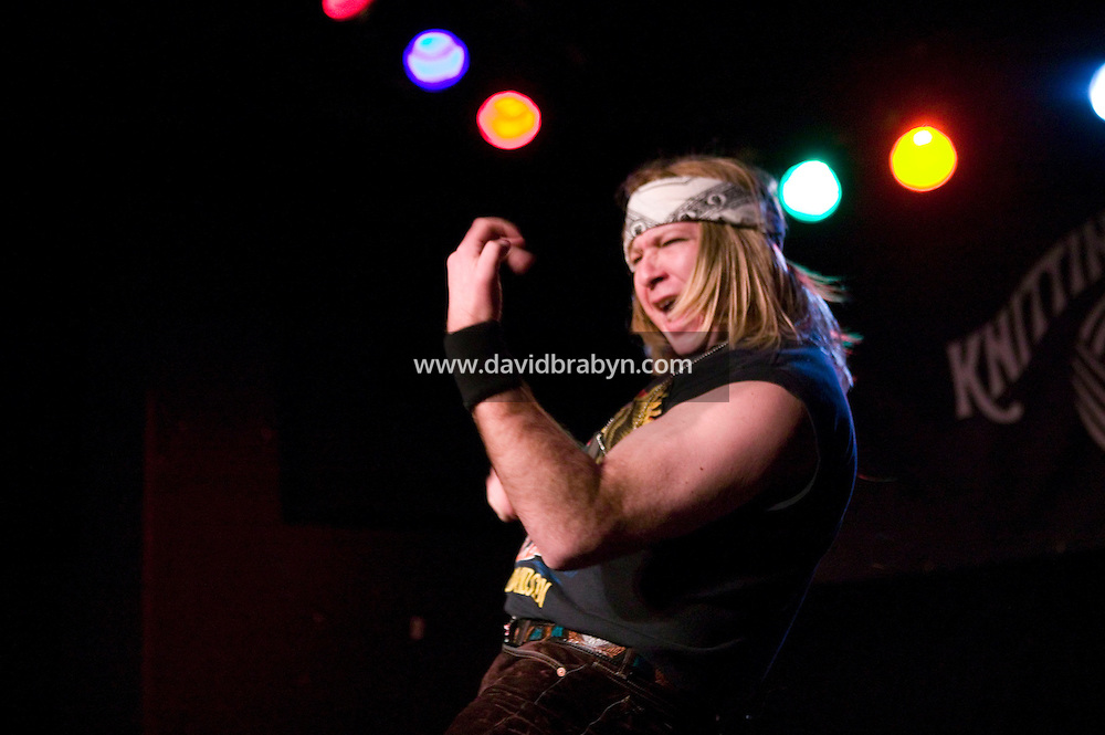 2 March 2006 - New York City, NY - David Katz, stage name Green Manalishi, performs on stage in an air guitar competition in New York City, USA, 2 March 2006. Air guitar is the act of pretending to play guitar with exaggerated strumming motion and loud singing or lip-synching. The first Annual Air Guitar World Championship took place in 1996 in Finland.