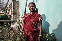 Shanti Mahato, 42 years old, lives in Dhatkidih,  photographed holding her perrot Mitho. Being the most successful business person in her village, she quickly attracted the attention and envies or other villagers. In 2006, after she tried to protect her daughter from a boy who was harassing her, she was accused of being a witch by the boy's family.