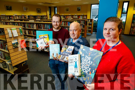 Pictured with the top ten books of the year at Kerry County Library on Friday last were l-r: John Horgan John O'Connell and Niamh Doyle.