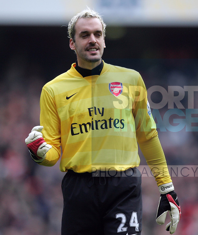 Arsenal's Manuel Almunia celebrates his penalty save