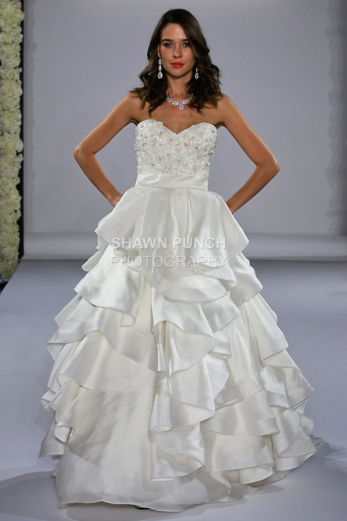 Model walks runway in a wedding dress from the Simone Carvalli collection, for the Couture Runway Show, during New York Bridal Fashion Week at The Hilton Hotel, October 13, 2012.